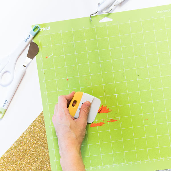 Use the scraper to remove materials from your mat