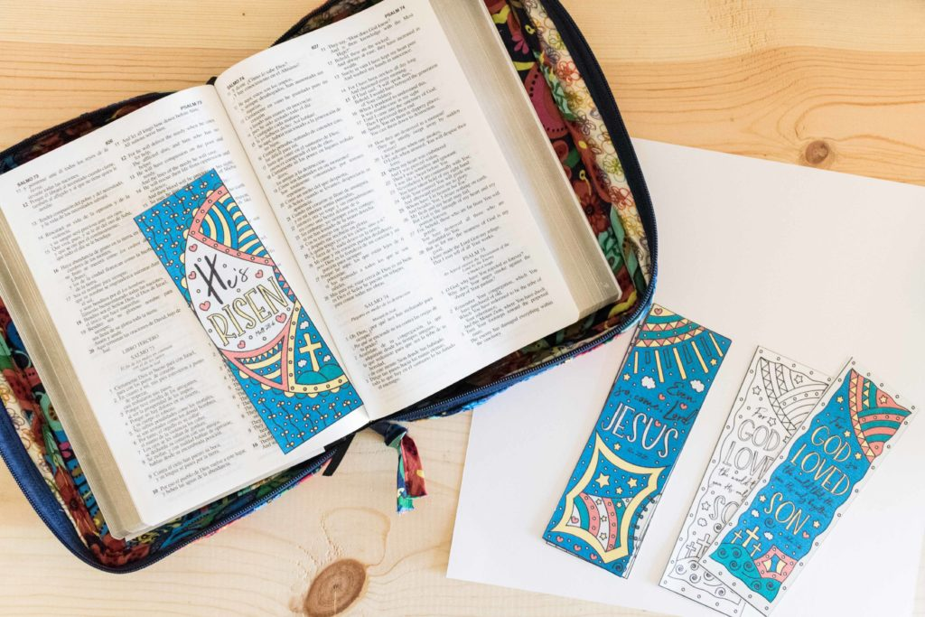 Bible with the He's Risen Easter Bookmarks