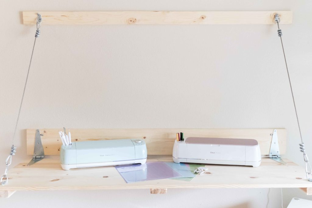 Cricut Explore Air 2 and Maker side by side with mats and other tools.