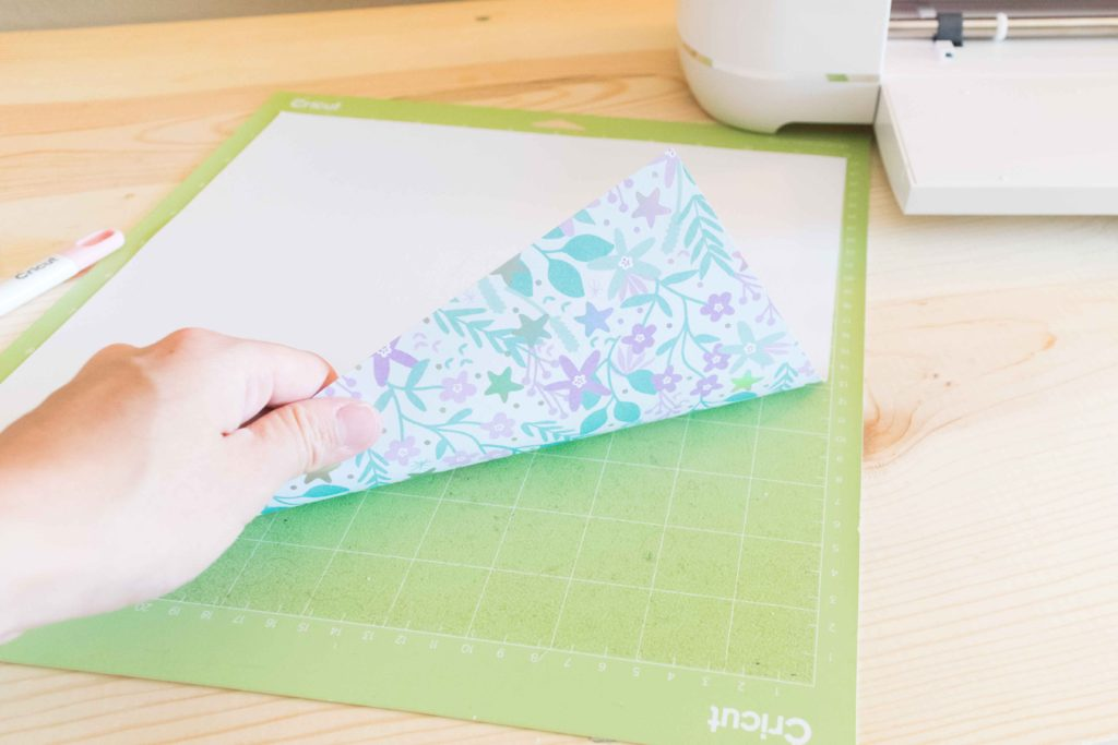 Placing Patterned paper pretty side down on Cricut Mat