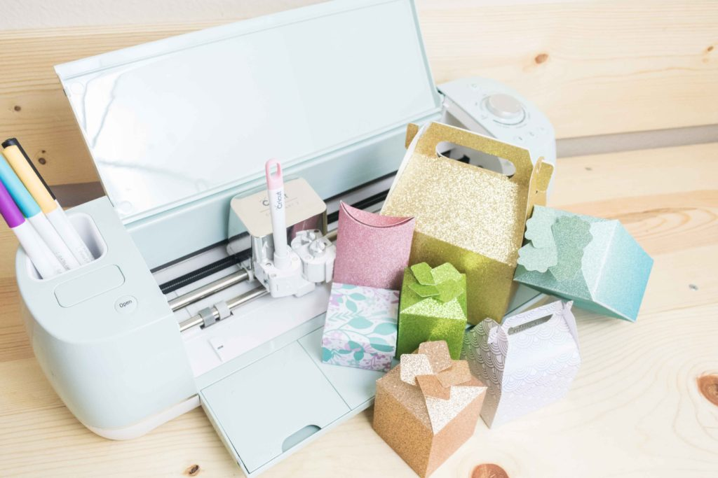 Cricut Explore Air 2 with multiple beautiful gift boxes on the side.