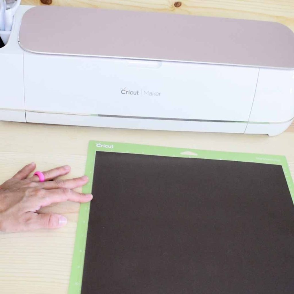 Placing Cricut Infusible Ink transfer sheet on Green Mat