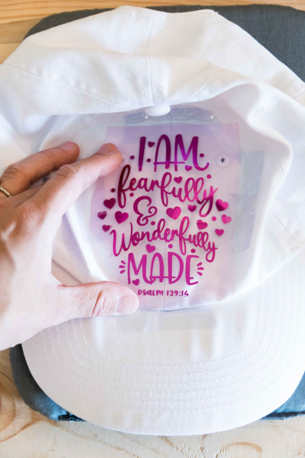 Taping design in a white hat with heat transfer tape