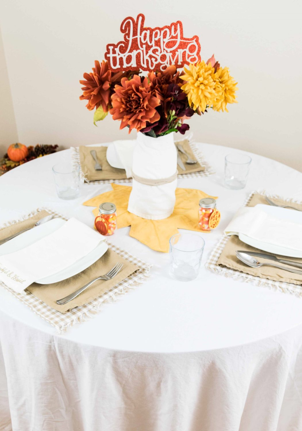 Thanksgiving table setting and decorated with the Cricut