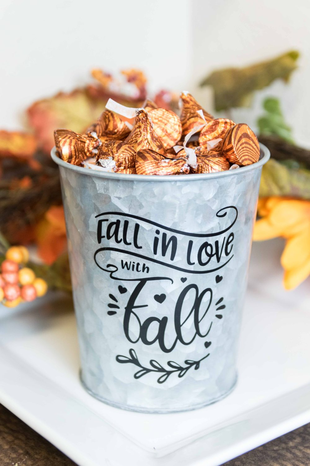 Metal Bucket decorated with black vinyl for the fall season