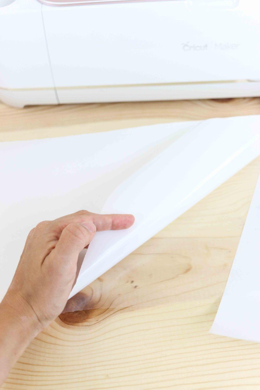 placing freezer paper on heat transfer carrier sheet