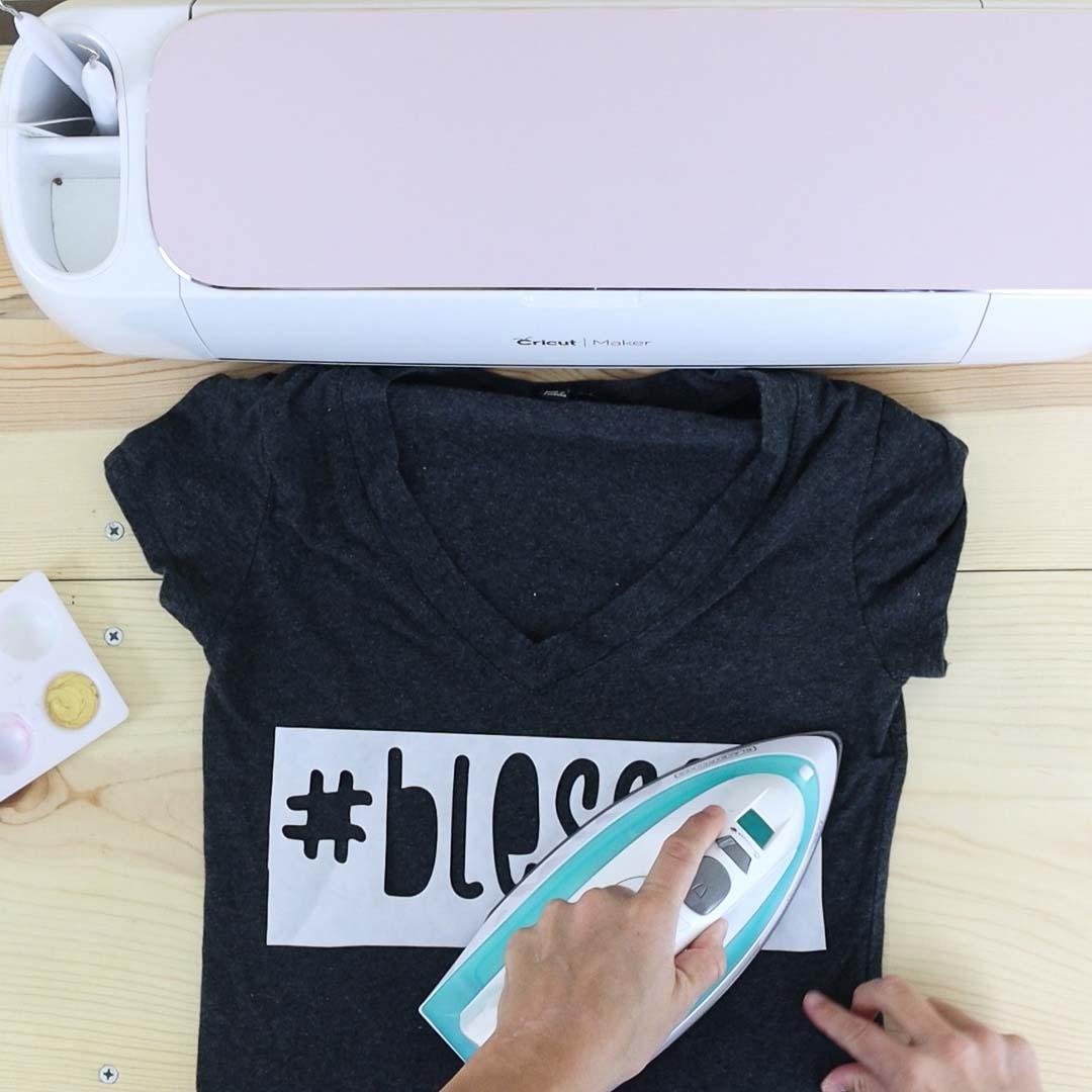 bonding freezer paper to a shirt with a regular household iron.