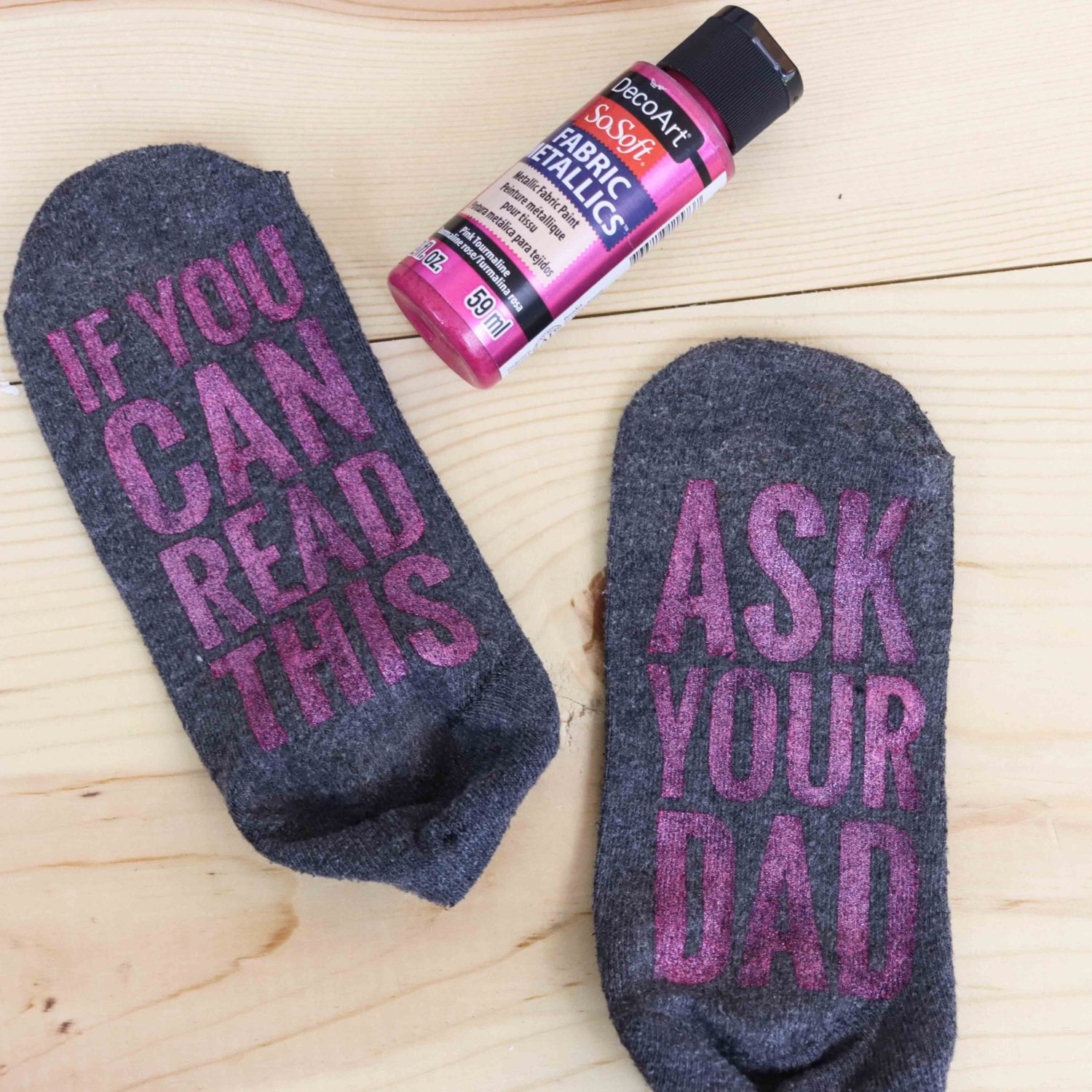 Grey Socks made with metallic fabric paint made with freezer paper and cricut