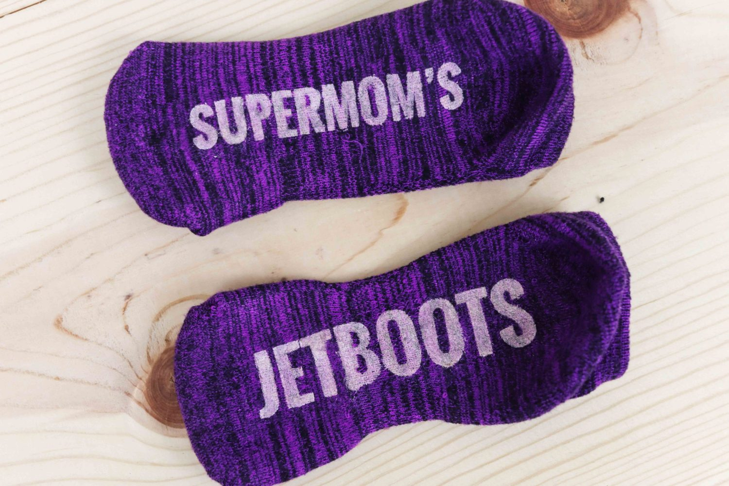 Purple Socks made with metallic fabric paint made with freezer paper and cricut