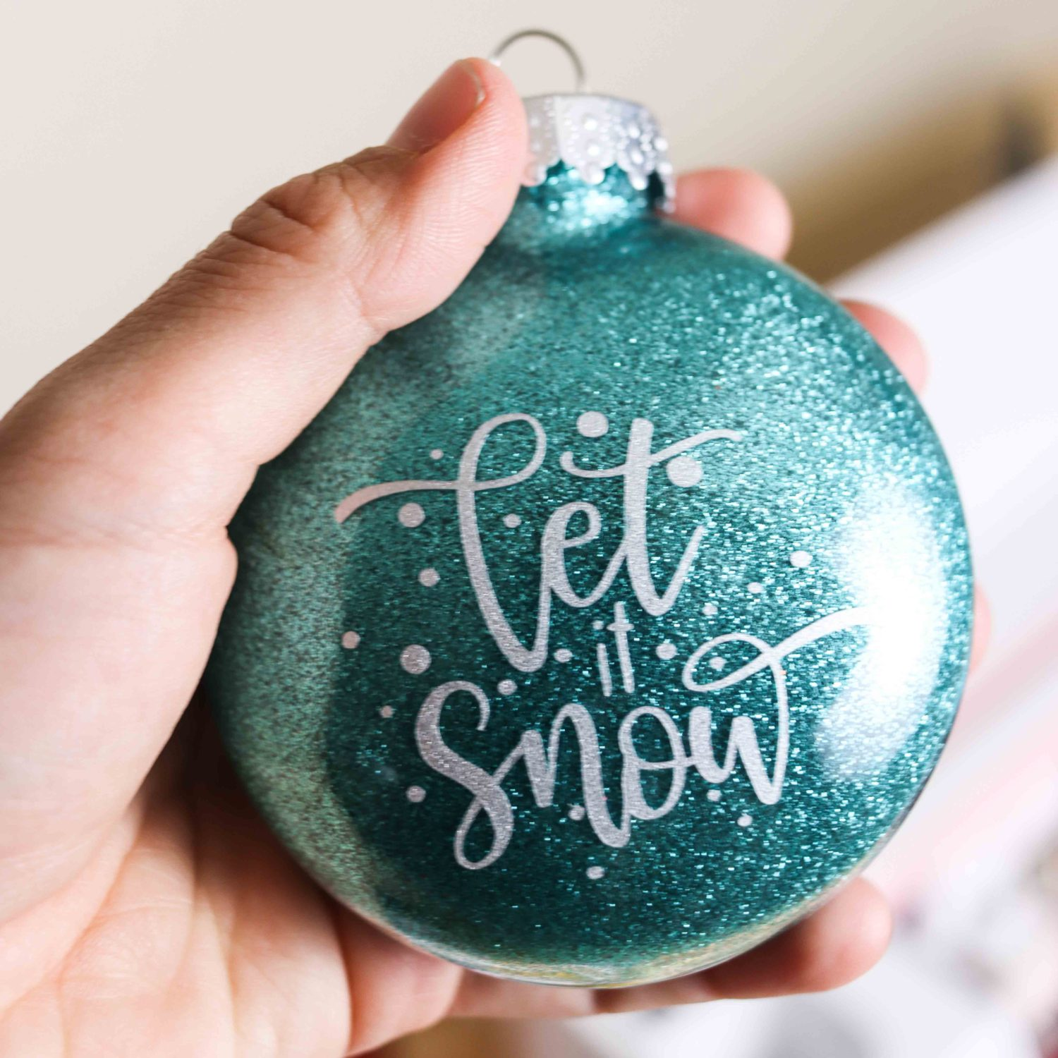 let it snow Christmas ornament made with Cricut