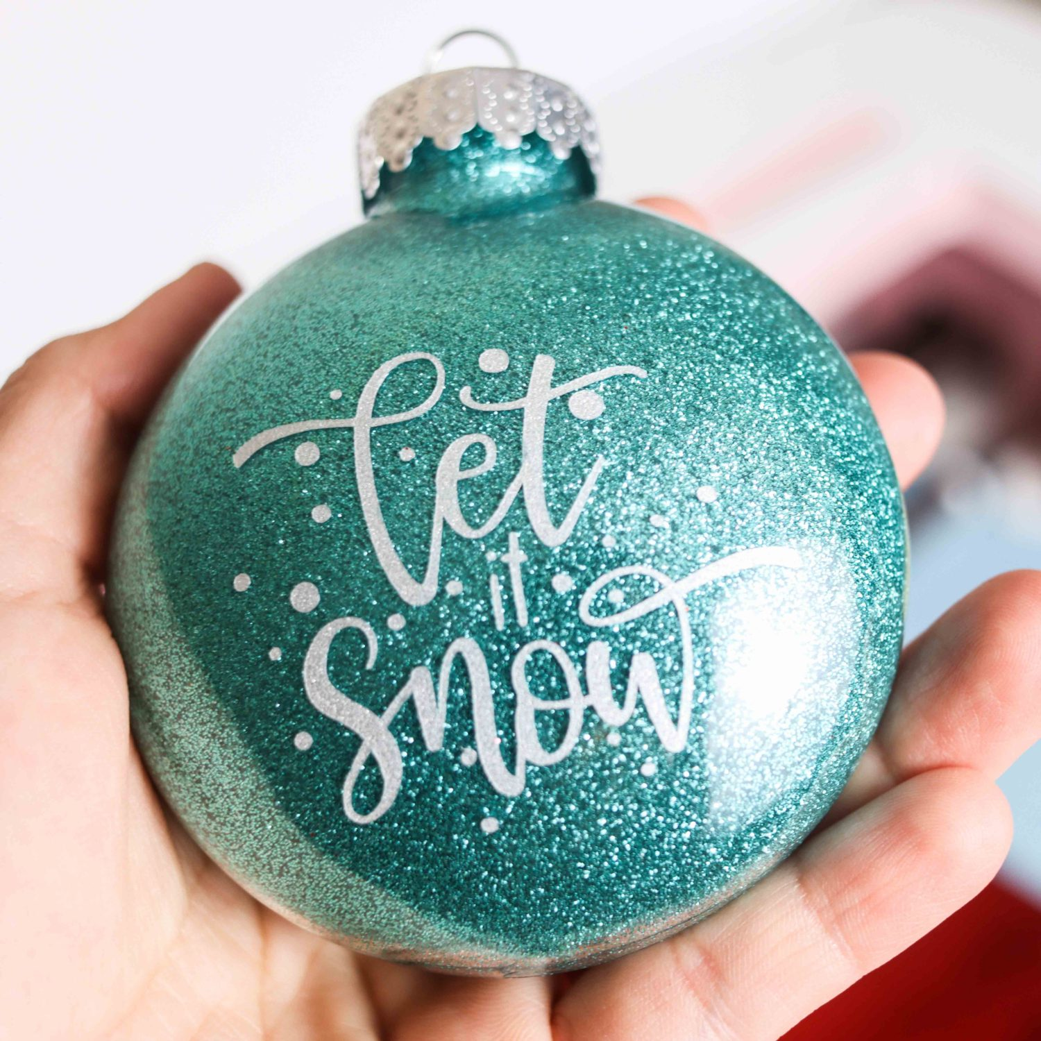 """blue glitter Christmas Ornament with """"let it snow"""" phrase"""