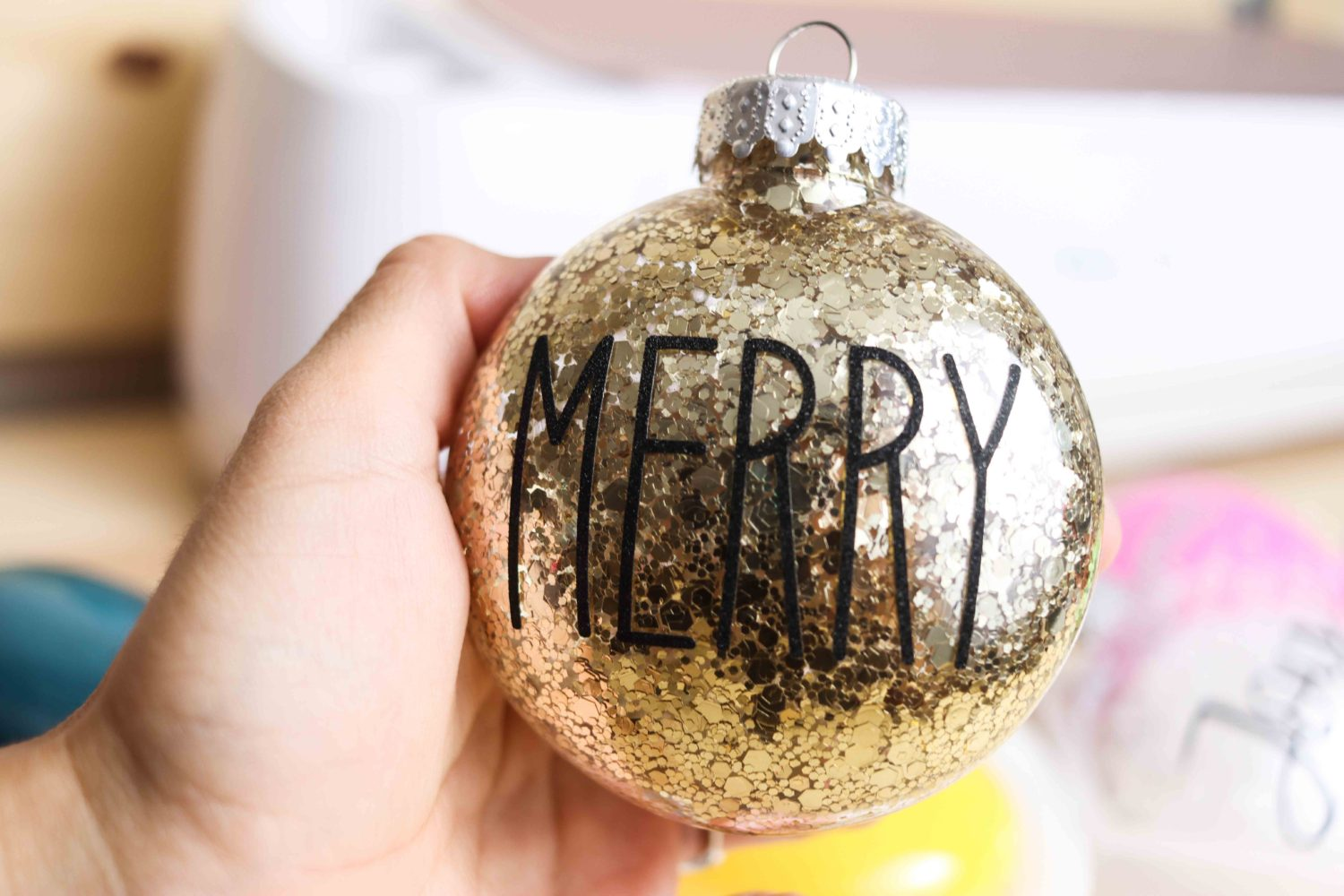 Merry christmas ornaments decorated with Cricut Maker