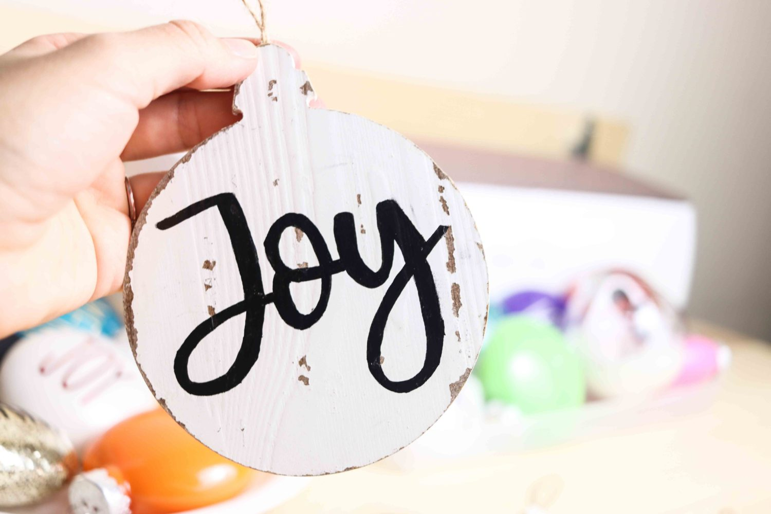 Painting wooden Christmas Ornament  with paint marker