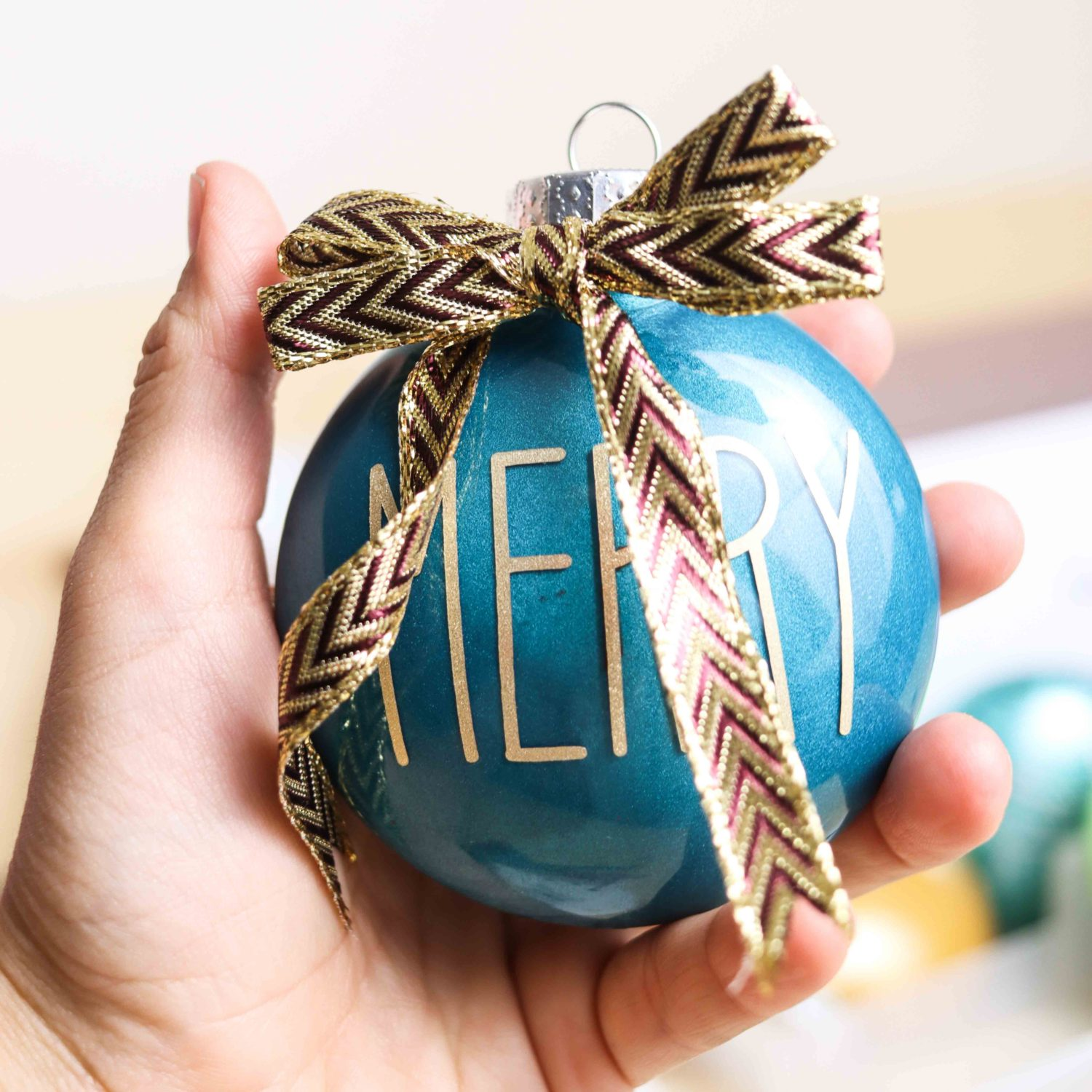 Christmas Ornament made with teal metallic pain and gold vinyl