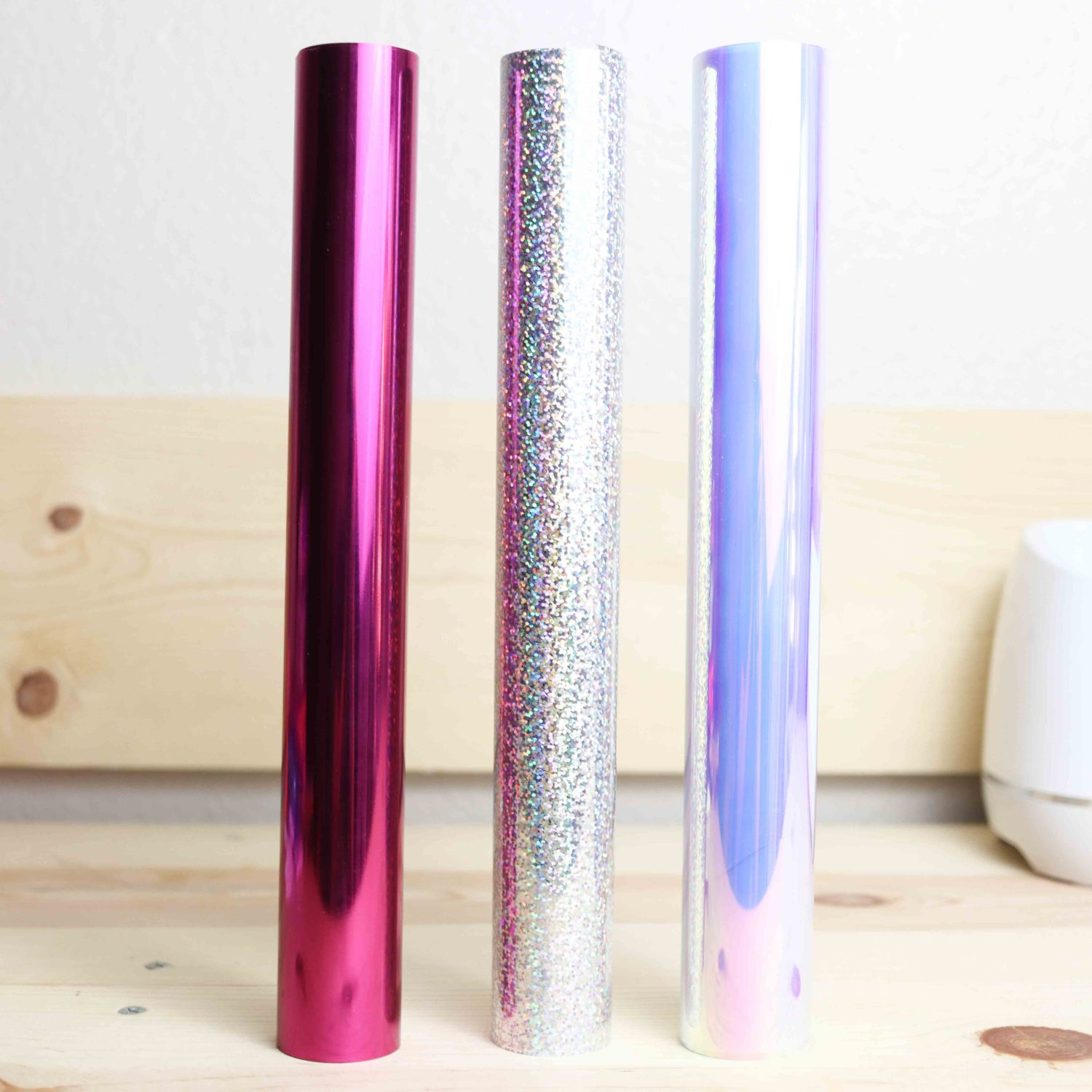 Foil, holographic sparkle and holographic iron-on rolls.
