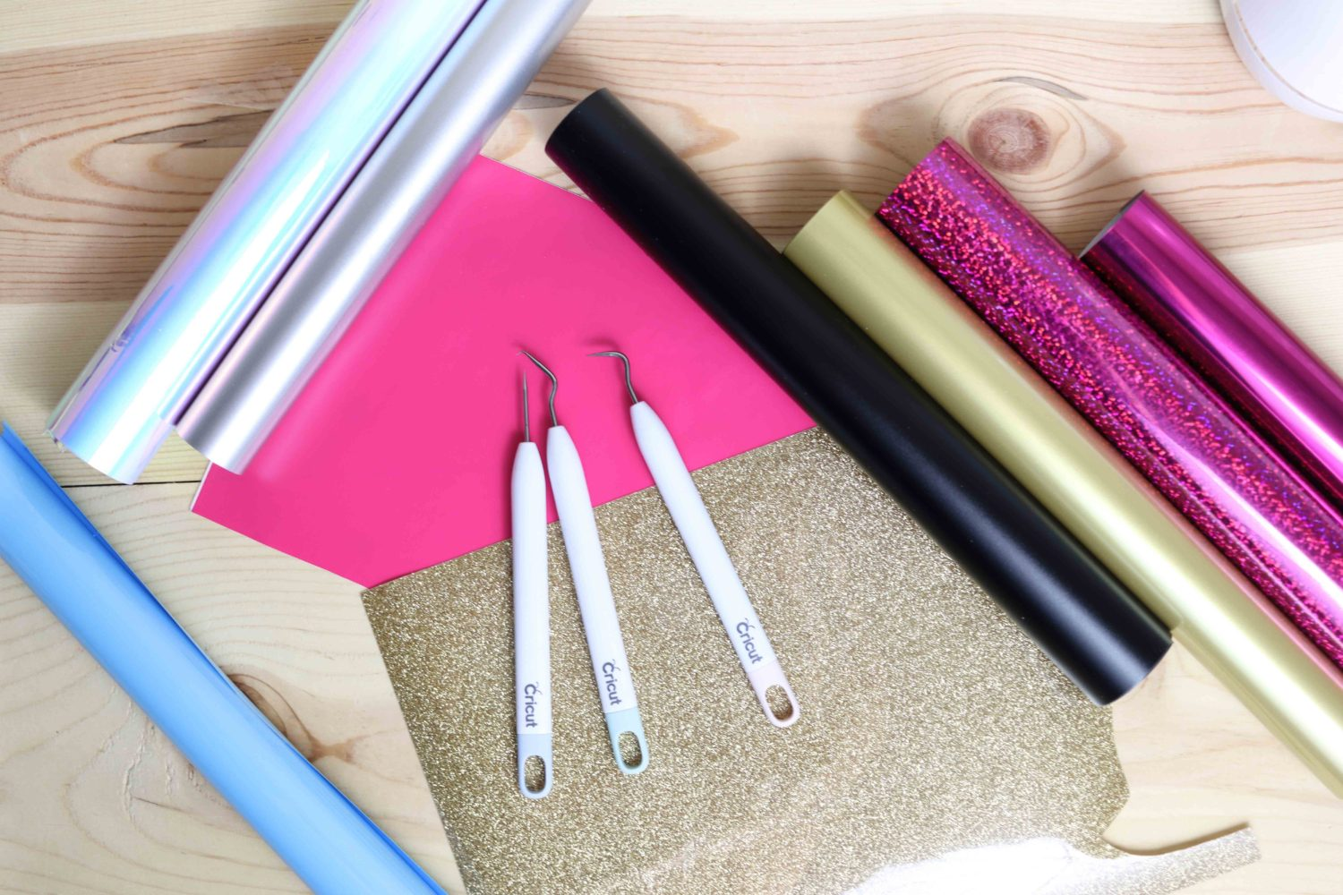 Different types of adhesive and heat transfer vinyl and weeder tools.