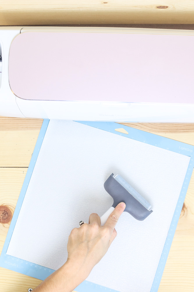 Using the brayer to place iron on Cricut mat