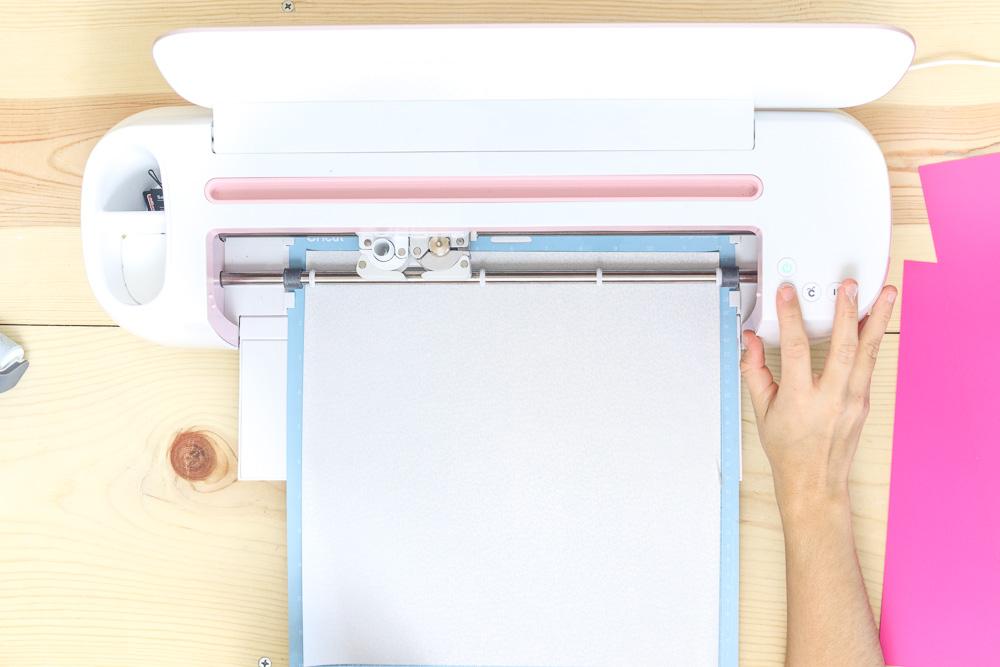 Uploading mat with holographic vinyl iron-on to Cricut machine