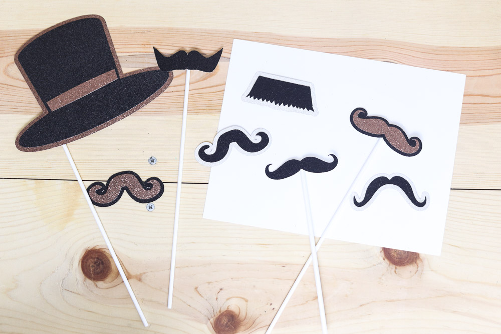 Mustaches photo props in different colors made with Cricut