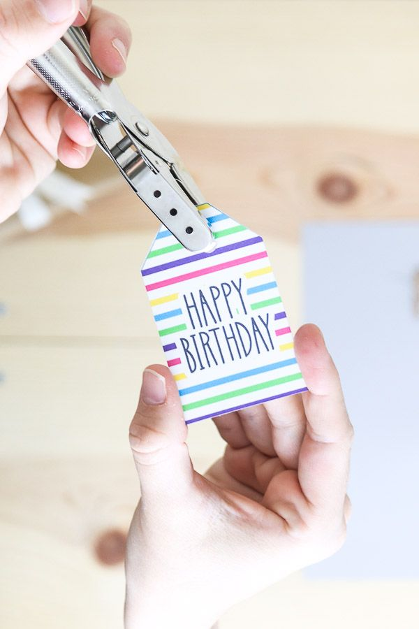 Using a punch hole to create an opening on a gift tag