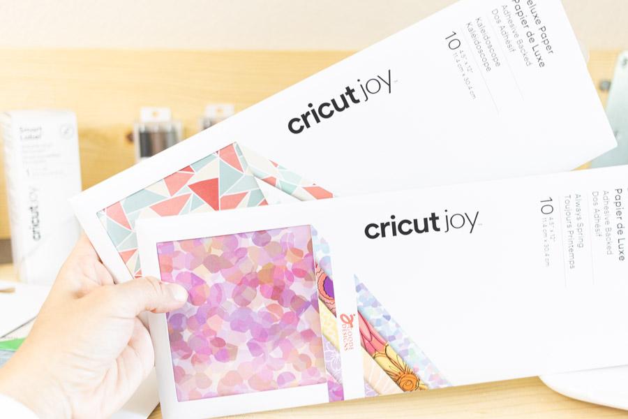 Holding Cricut Joy Deluxe Paper