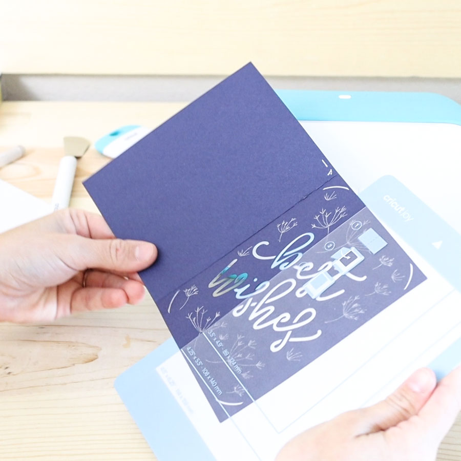 flipping card inside out and putting on Cricut Joy card mat