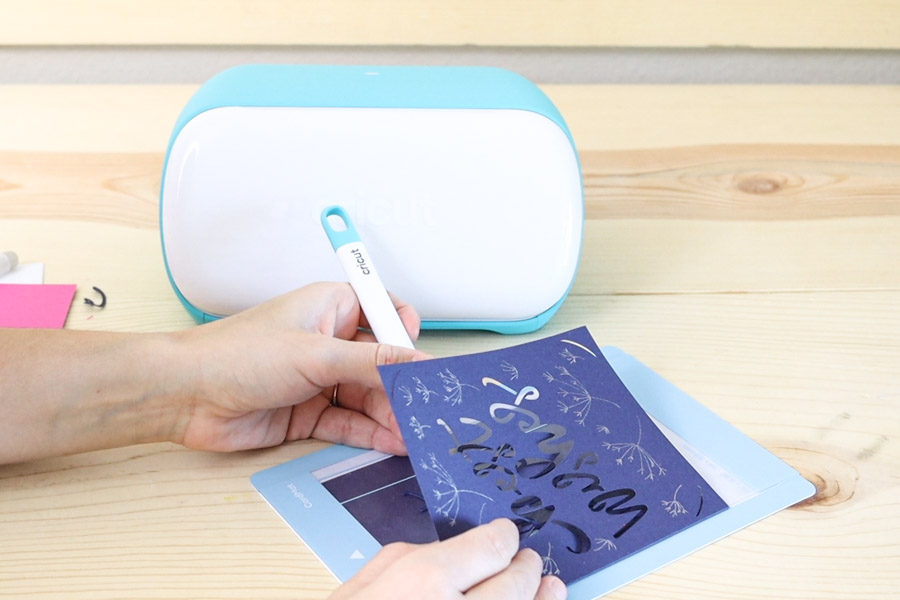 Removing card from card mat with the spatula