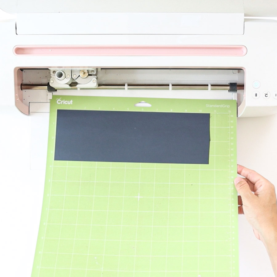 loading mat (with iron-on) to cricut