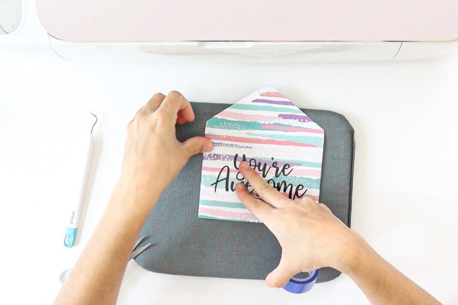 placing iron-on design on envelope