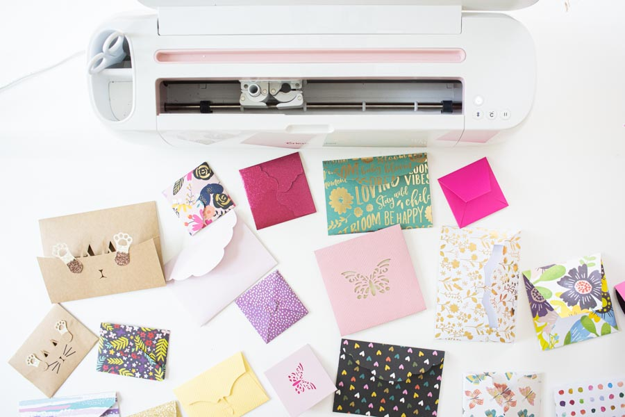 assorted envelopes in shapes, colors made with cricut