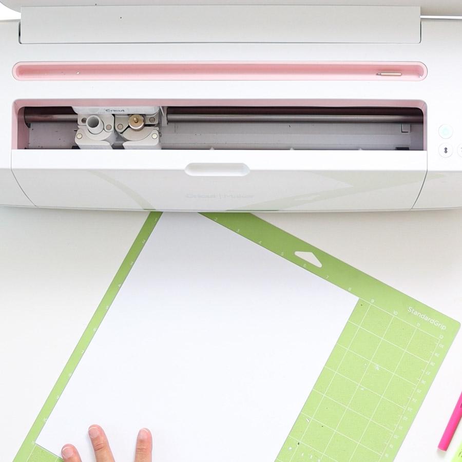 placing copy paper on cricut mat