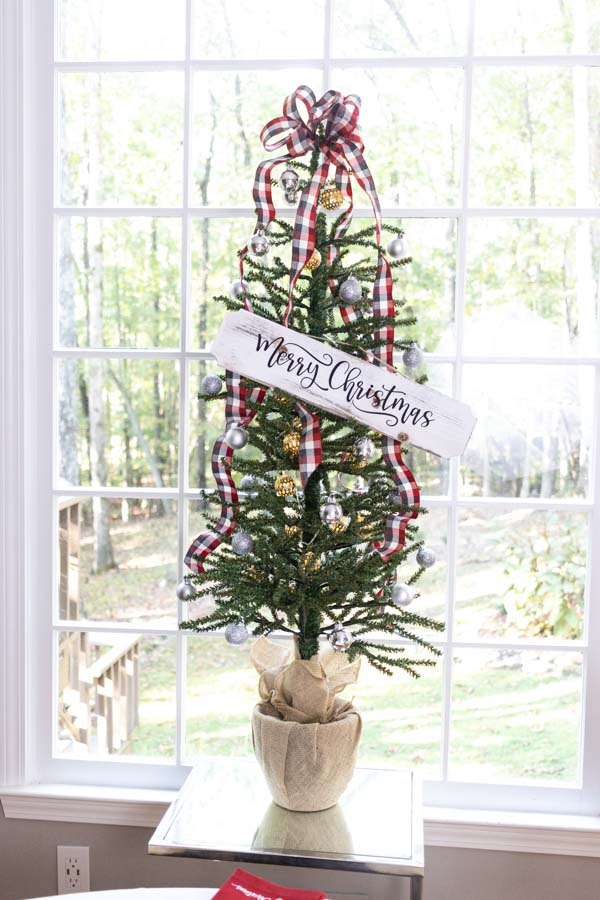 christmas tree with wooden sign