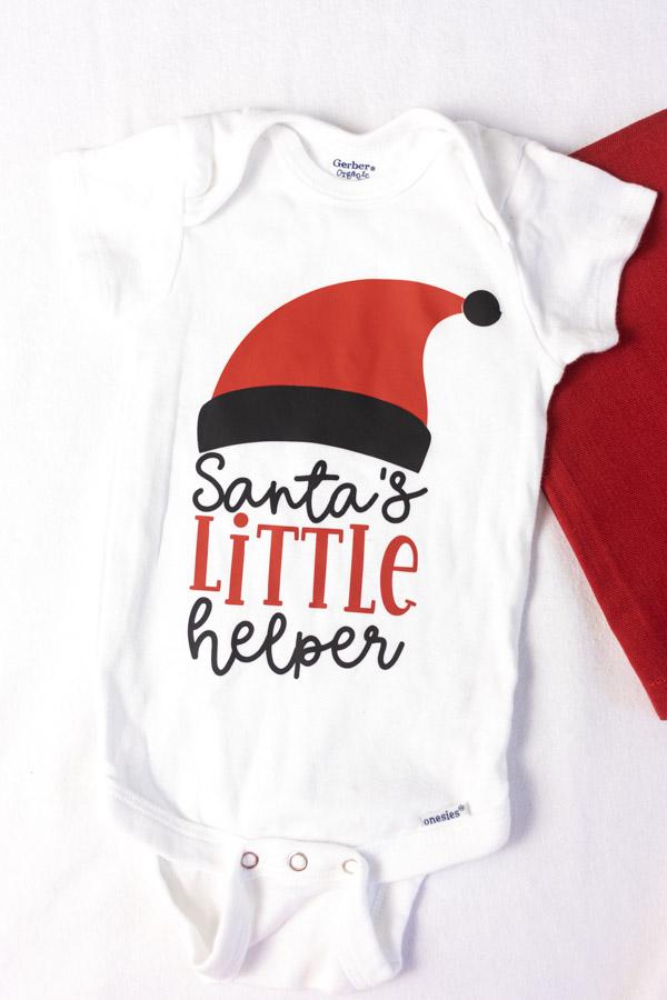 Santa's little helper onesie made with Cricut