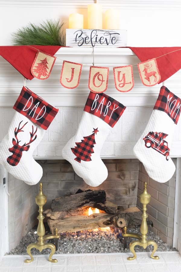 Fire place decorated for Christmas with Cricut