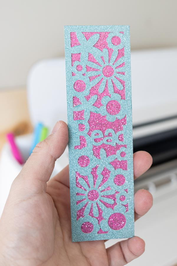 """""""Read"""" bookmark with floral cut-outs made with Cricut"""