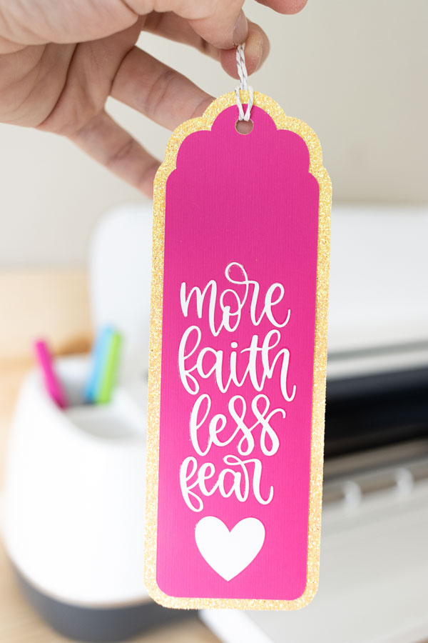 More faith less fear bookmark made with Cricut Iron-on and pink and yellow cardstock.
