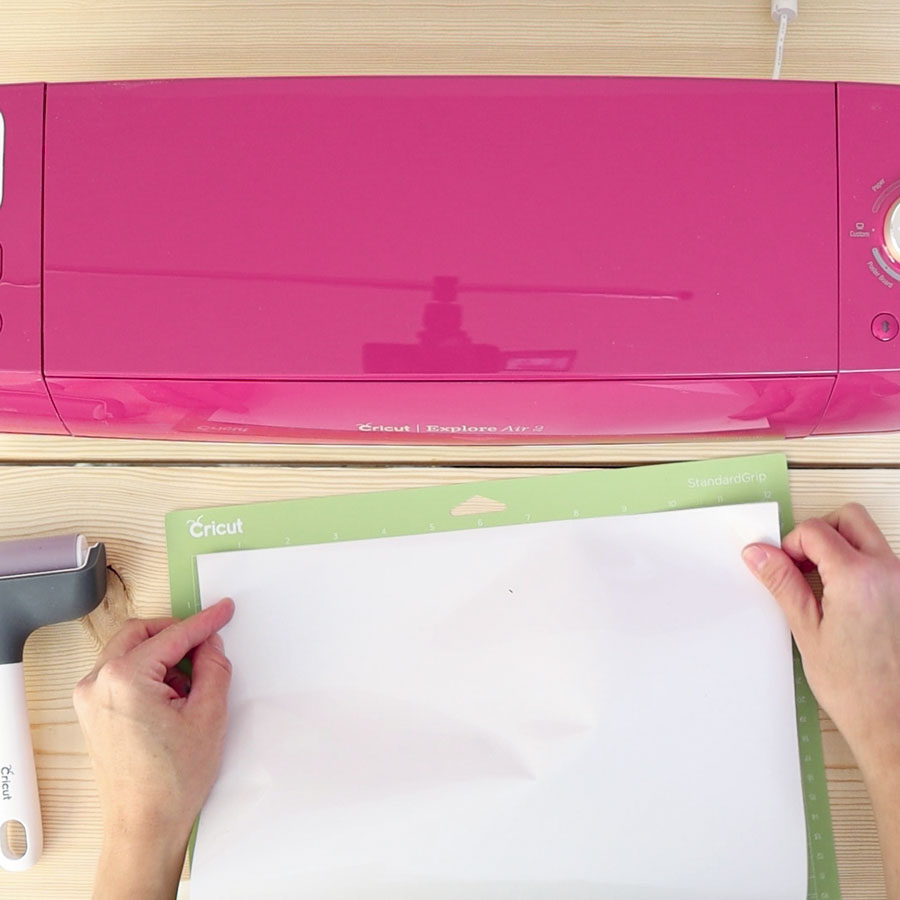 placing vinyl on cricut mat