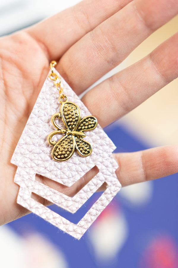 triangle and butterfly earring made with cricut