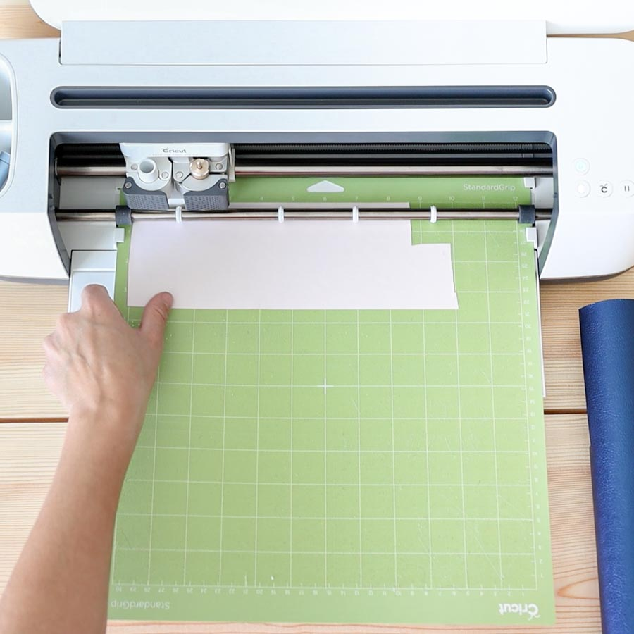 place iron-on on cricut mat and insert on machine