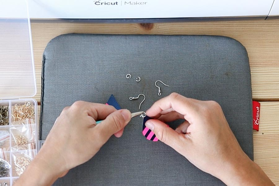 adding jump rings and fish hooks to earrings.