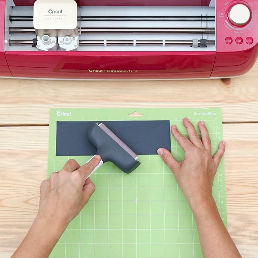 placing iron on on cricut mat
