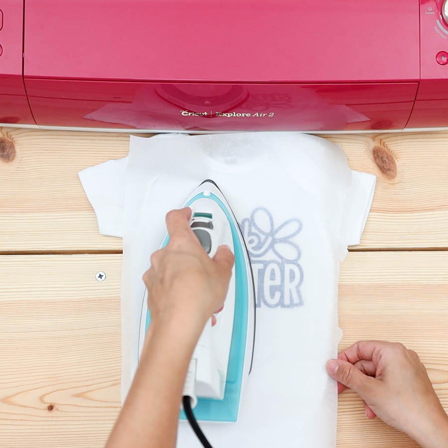 pressing onesie with iron on design and household iron