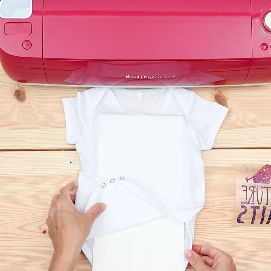 placing cardstock inside baby bodysuit