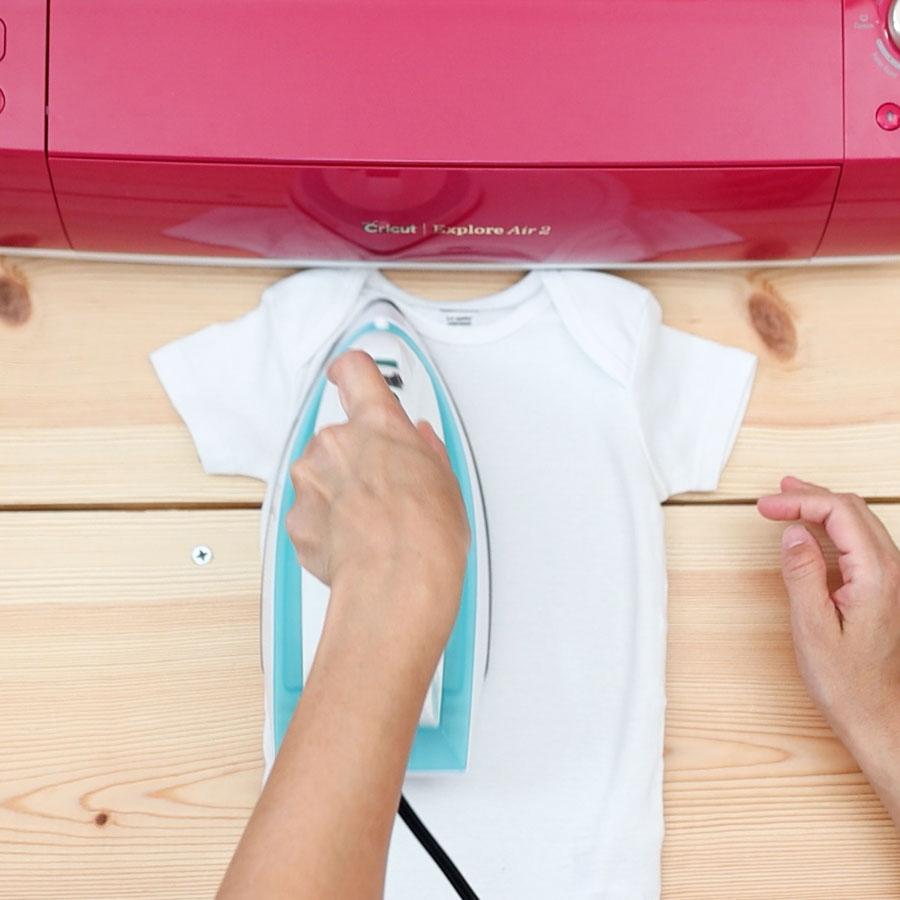 pressing onesie to get rid of moisture, wrinkles