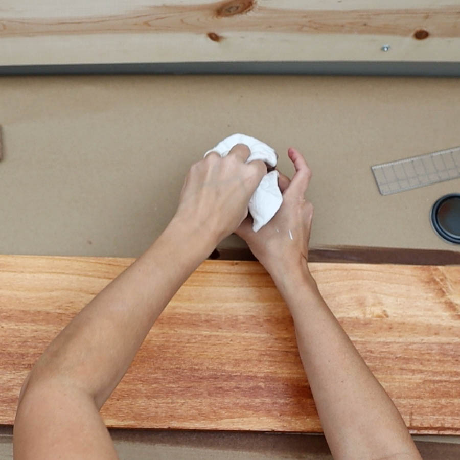 using a cloth to stain wood