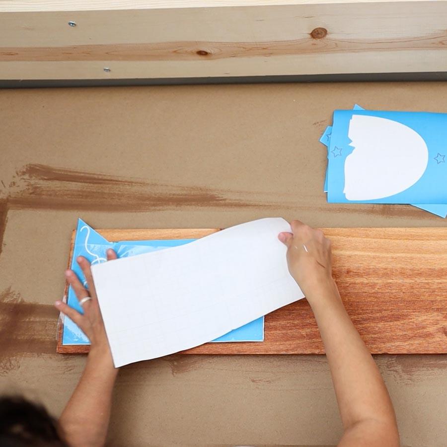placing transfer tape on stencil vinyl