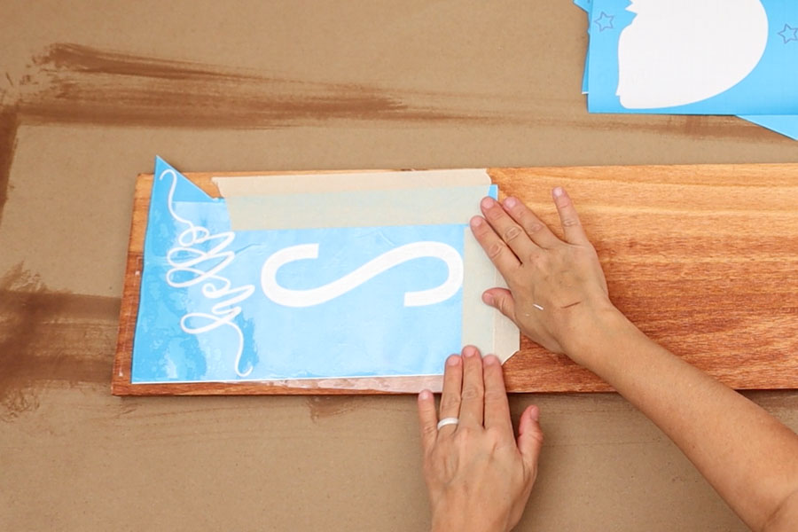 securing stencil vinyl and transfer tape to wood with masking tape