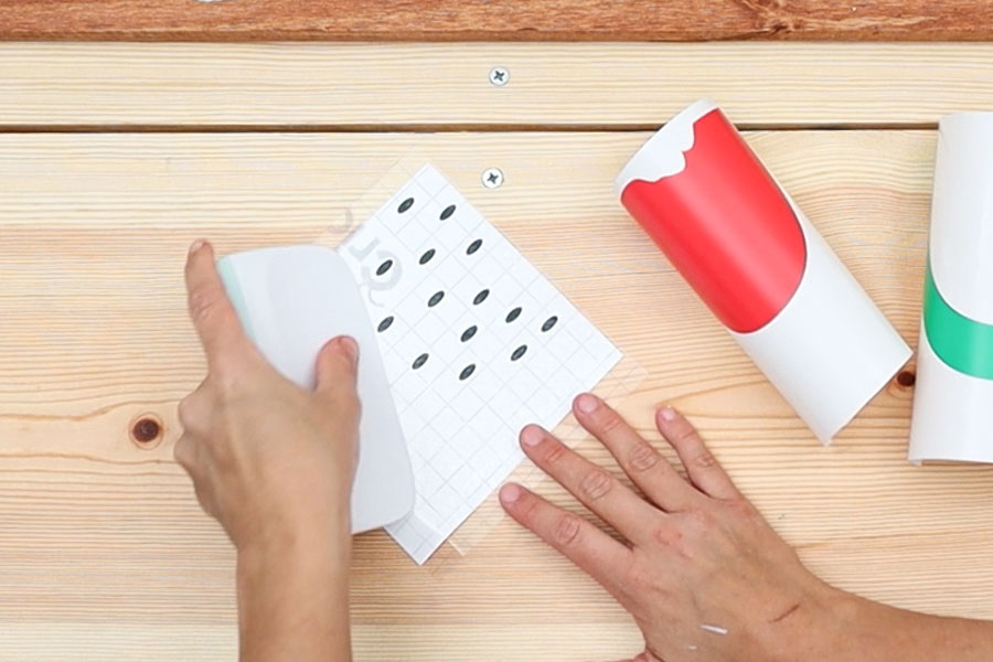 using squeegee to bond transfer tape with vinyl