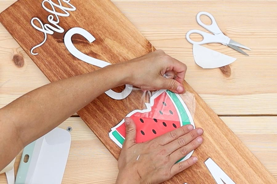 removing transfer tape from adhesive vinyl on wood