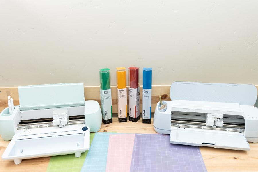 cricut explore 3 left, maker 3 right. Along with cricut mats and mart vinyl